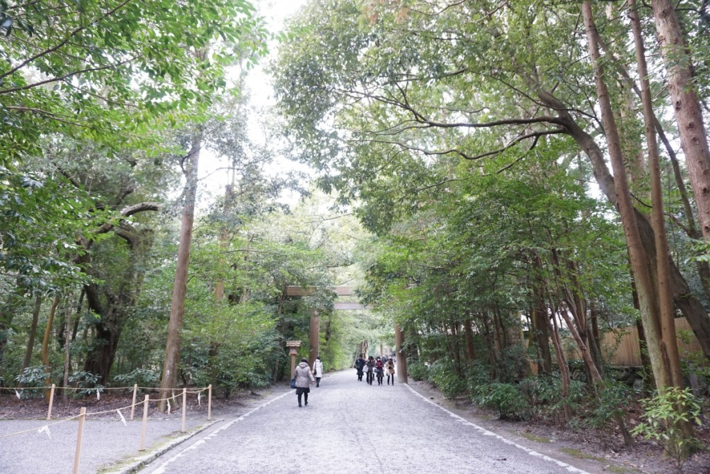 Naiku gravel path surrounded by deep forests.