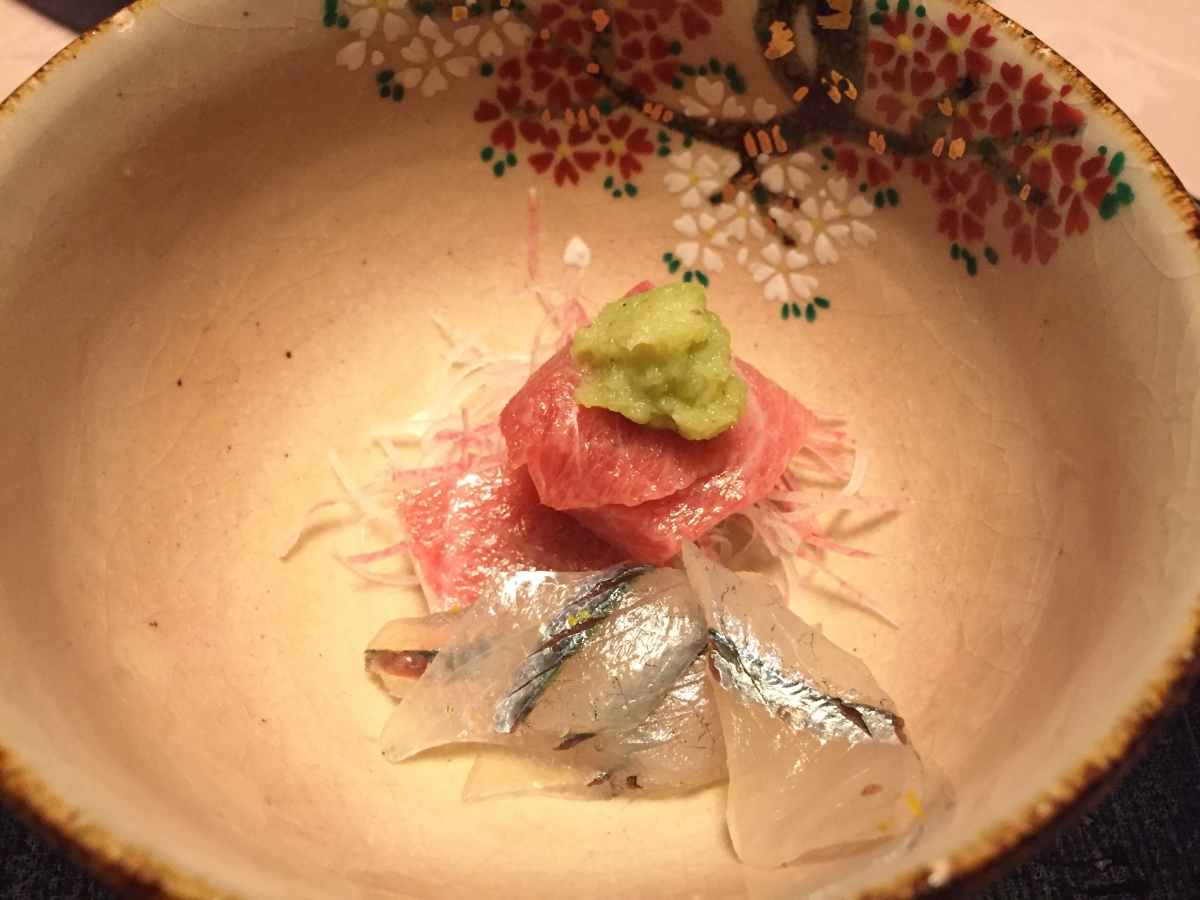 a beautiful arrangement of sashimi in a bowl