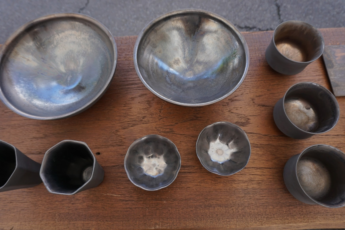 brown and black bowls with a partially shiny glaze